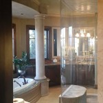 Elegant custom bathroom upgrade with curved glass shower enclosure