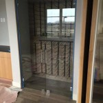 Custom glass wine cooler kitchen remodel
